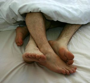 Gay_Couple_togetherness_in_bed_01